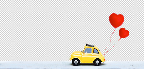 Clipping path. Miniature car with two red heart balloon. concept of love wedding honeymoon