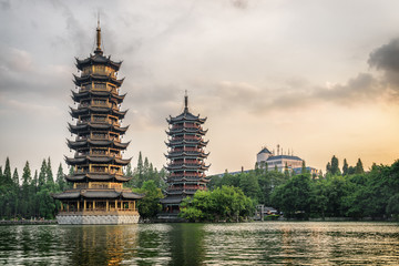 Zelfklevend Fotobehang Guilin The Sun and Moon Twin Pagodas at sunset, Guilin, China