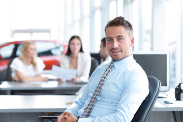 portrait of confident businessman sitting at the Desk