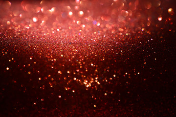 Sparkling of bokeh, bright red background.