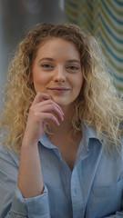 Attractive blonde woman portrait in blue shirt