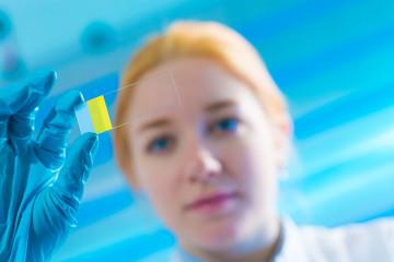 scientist woman holding microscope slide