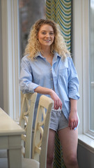 Beautiful blonde portrait in modern home interior