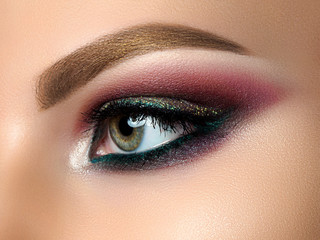 Closeup of beautiful woman eye with fashion makeup