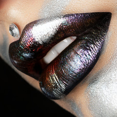 Close up view of woman lips with fashion makeup