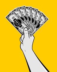 Hand holding money bills