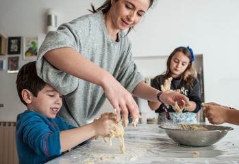 family making cookies at home