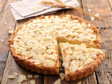 almond cake on wood background