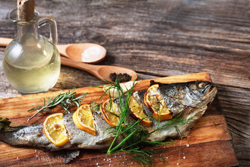 fish on rustic table with fresh ingredients for cooking