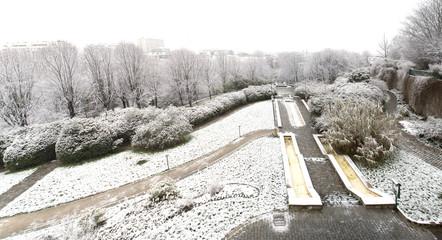 Park of Belleville district in Paris under the snow, France
