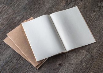 Blank A4-size open book  mock up, catalog, magazines, brochure, note template with paper texture on dark color wood table