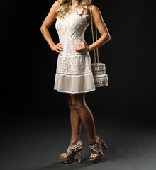 Attractive Woman in a White Lace Designed Dress and Wedding Cake Purse