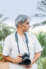 attractive white hair man making photos.