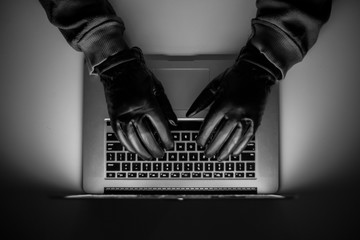 Cybercrime, a laptop hacker, writes codes to access unauthorized things, an illegal way, hacker, crime, cyber