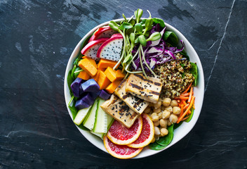 colorful buddha bowl with grilled tofu and dragon fruit
