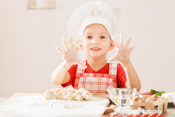 cooking pizza is fun - little chef playing with flour