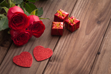 occasional beautiful red roses with decorative hearts and tiny boxes of gifts