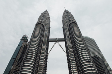 Low angle view of Petronas Towers against sky in city
