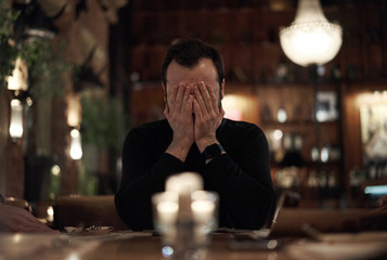 frustrated man in a restaurant