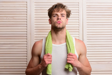 Man with green towel around neck. Morning exercises and sport