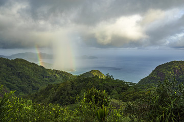 rainbow and rain over the jungle and mountains of mahé, seychelles 16