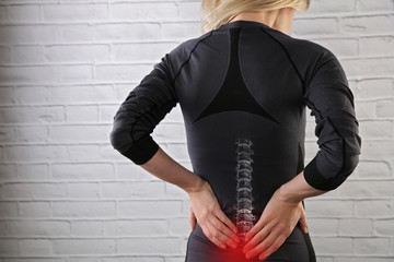 Woman suffering from back pain. Sport exercising injury, Muscle spasm, Pain relief , chiropractic concept.