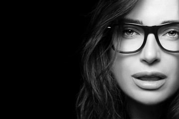 Cool Trendy Eyewear. Beautiful Young Woman in Glasses.