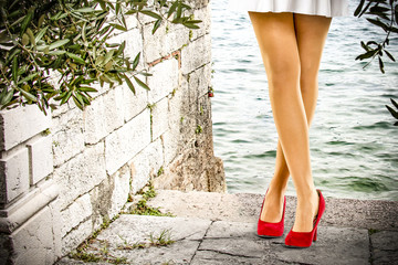 slim woman legs and red heels