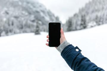 Telefon. Góry zimą.