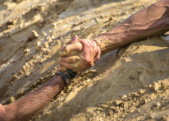 Helping hands in mud