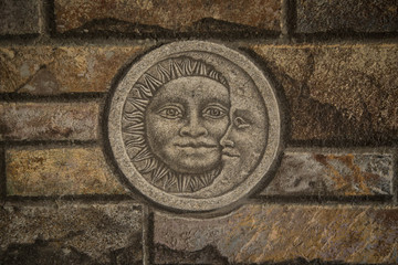 Brick wall with sun and moon motif
