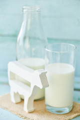 milk bottle, glass of milk, figure cow concept rustic food, fresh food on wooden.