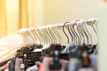 Clothes on hangers on a rack. Vintage tone.
