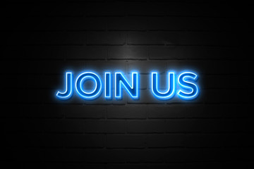 Join Us neon Sign on brickwall