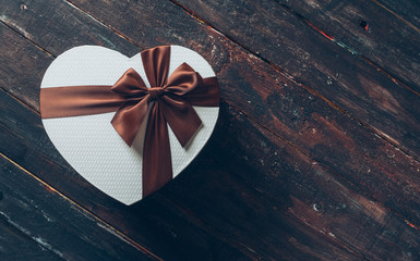 Heart Shaped Box on Rustic Wooden Background