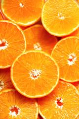 Fresh sliced orange fruit texture. Macro, top view, copy space. Food frame. Juicy oranges background