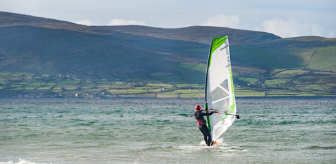 wind surfer in the ocean near the Dingle peninsula on the west coat of Ireland