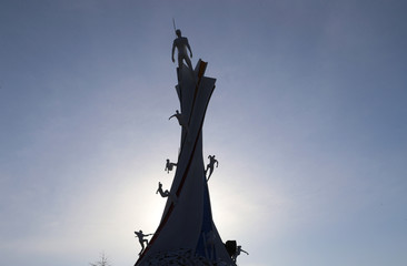 Statues featuring different winter sport disciplines are seen on the top of the Olympic Cauldron for the upcoming 2018 Pyeongchang Winter Olympic Games at the Alpensia resort in Pyeongchang