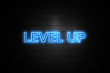 Level Up neon Sign on brickwall