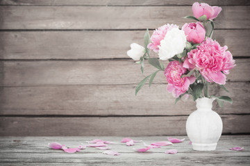 beautiful peony on old wooden background