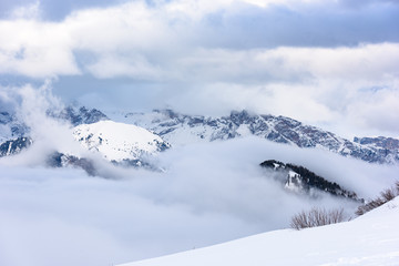 Dolomites. Winter views in the fog and low clouds