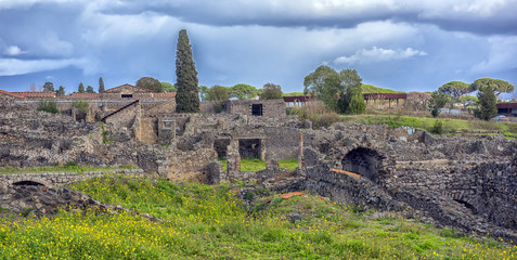 Italy, Pompei, 02,01,2018    Ruins in Pompeii and in background Vesuvius, Italy