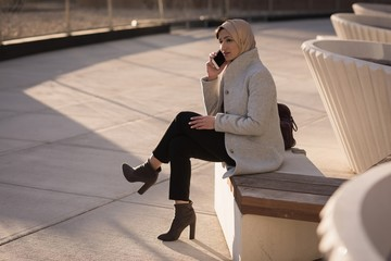 Woman in hijab talking on mobile phone
