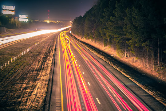 super highway with high volume of cars at night