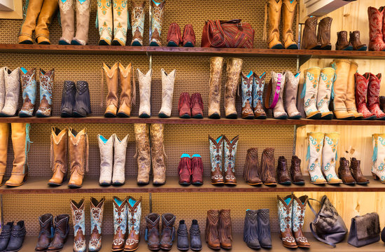 Cowboy boots on a shelf in a store, front view