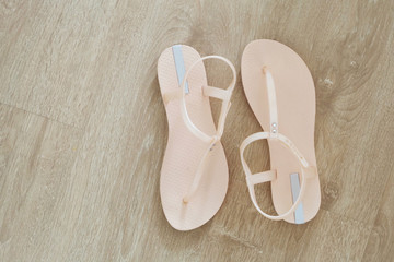 Pink Pastel Sandal Top View. Pair of Woman is Sandals Isolated (Footwear) on Wooden Background Great For Any Use.