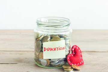 Coins in jar with Donation label