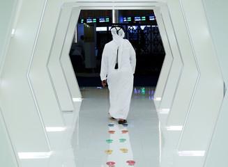 An investor walks into the Dubai International Financial Market in Dubai.