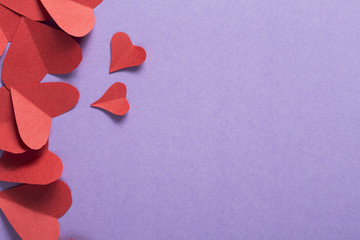Background of scattered red paper hearts for Valentine's day