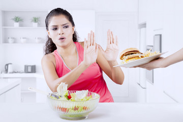 Indian woman refusing hamburger